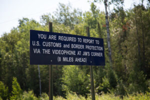 Border control sign requiring visitors to check in