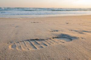 Footprint in the sand on a beach